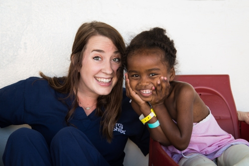 ©2015 Mercy Ships - Photo Credit Katie Keegan - Ward Nurse Jarah Nordin (USA) plays with Stivanna of Madagascar on Deck 7